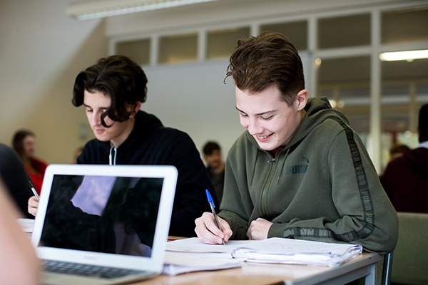 two students working together in class