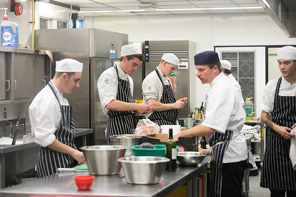 catering students working in the college kitchen