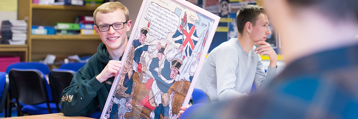student holding up a historical poster