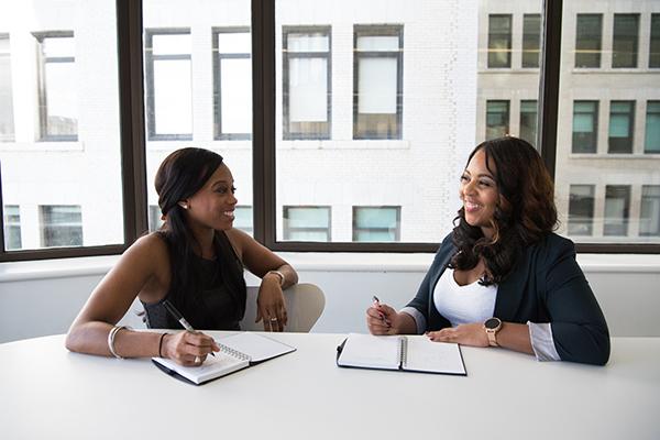 two women having a meeting