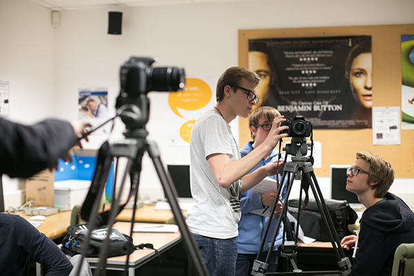 students working with camera equipment