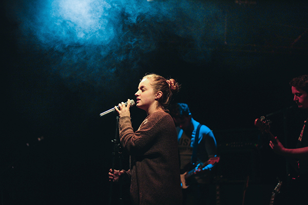 a student singing on stage