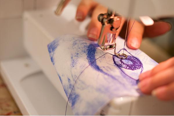 someone using a sewing machine