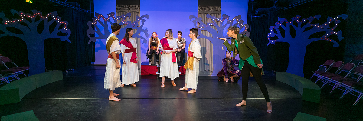 a group of students acting out a play