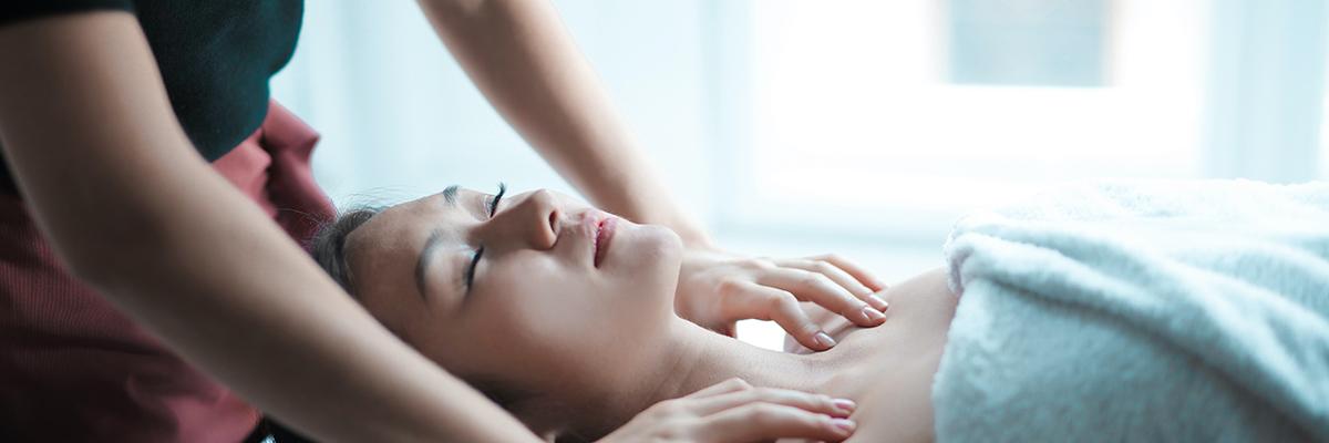 a woman having a shoulder massage
