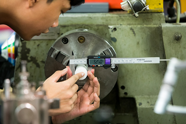 close up of measuring something in the engineering workshop