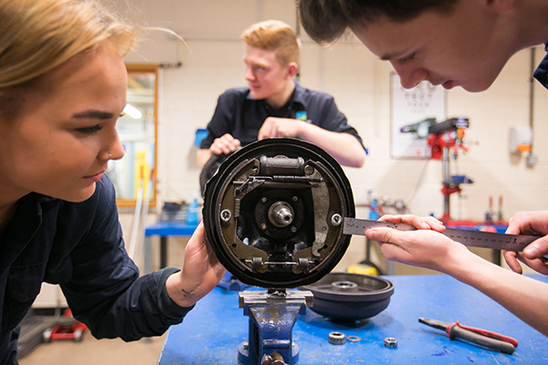 engineering students measuring something in the workshop