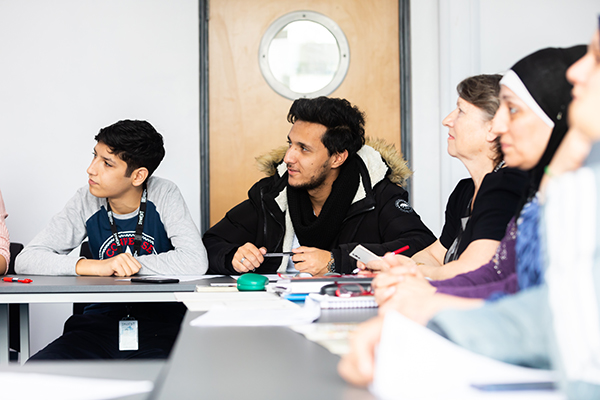 ESOL students listening in class
