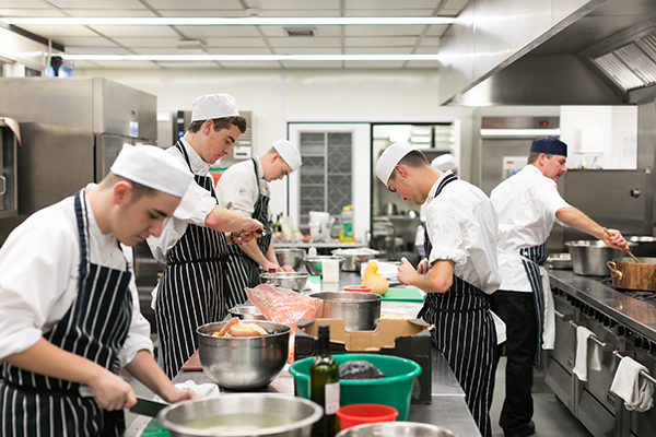 students in college kitchen