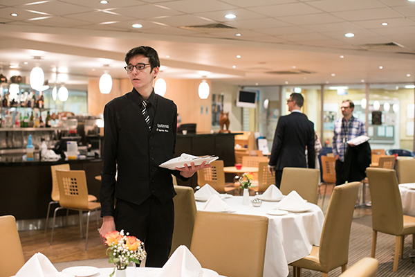 a student serving in the college restaurant