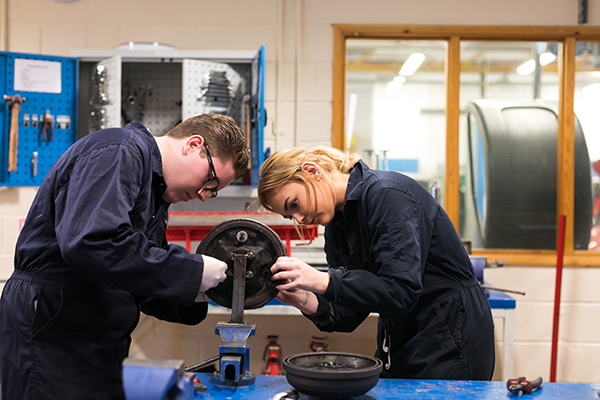 two students working in an engineering workshop