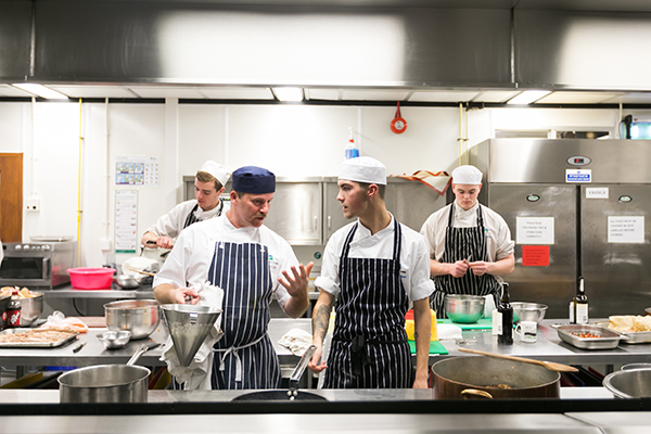 catering students in the training kitchen
