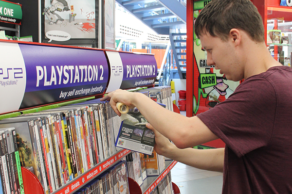 skills for independence and work student working in a game store