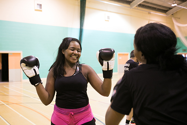 student with boxing gloves on