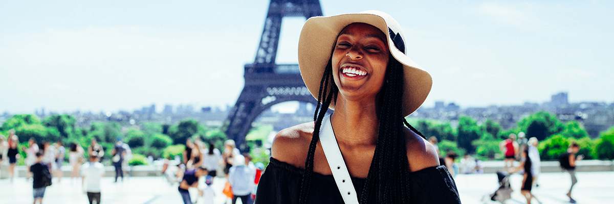 a woman standing in front of the Eiffel tower