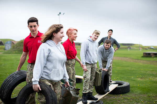 public services students participating in an activity in a field