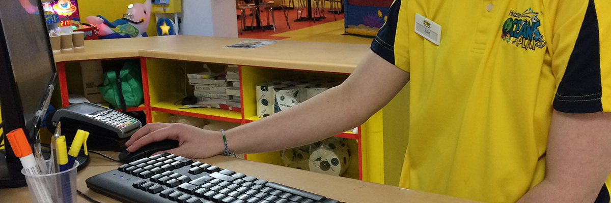 student working at a till