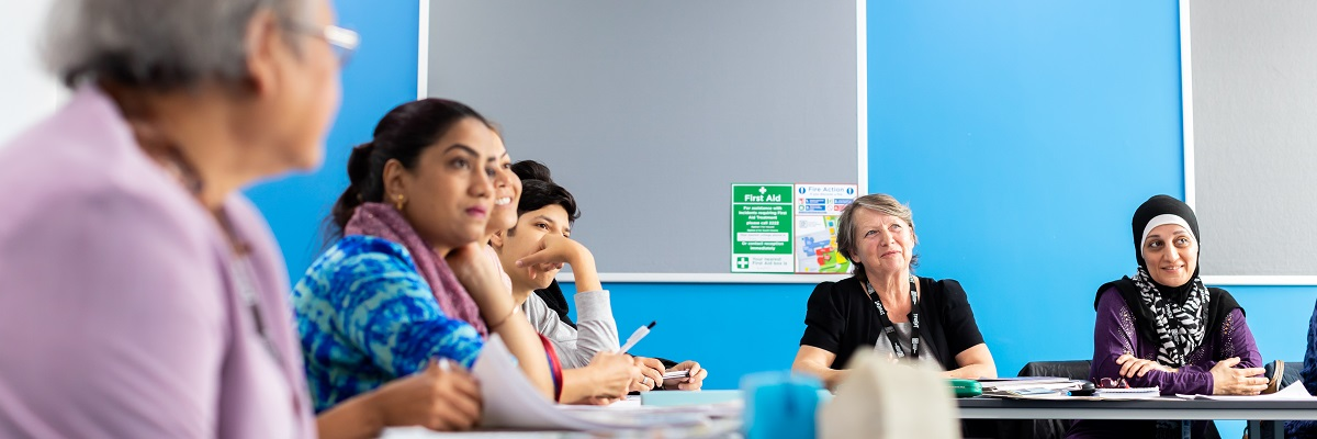 group of ESOL students listening in class