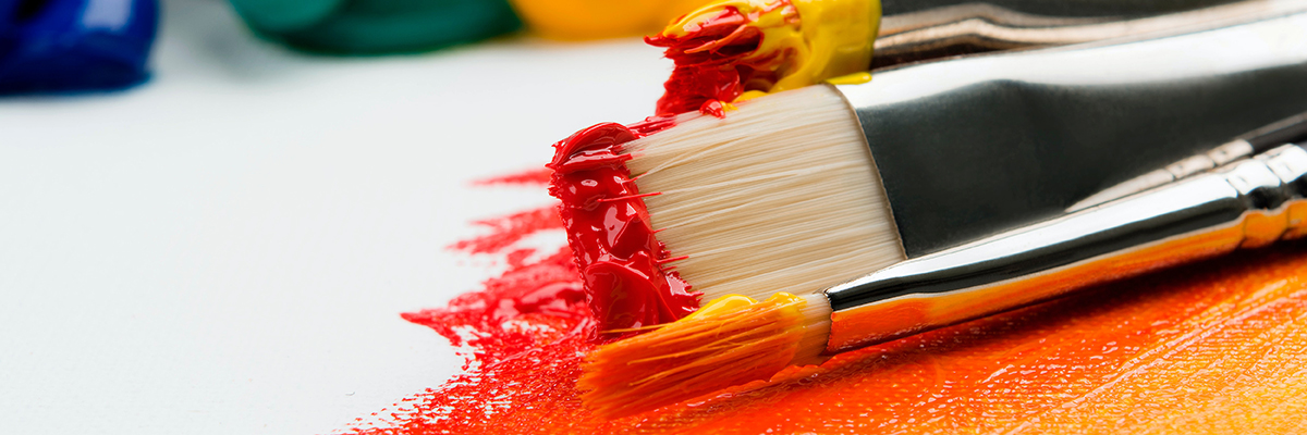 close up of paint brushes with different colour paint