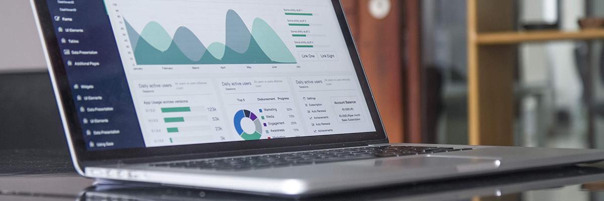 close up of a laptop displaying data graphs