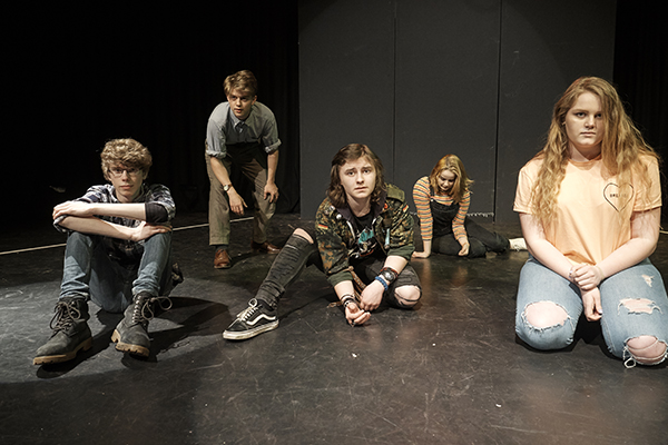 drama students posing on stage