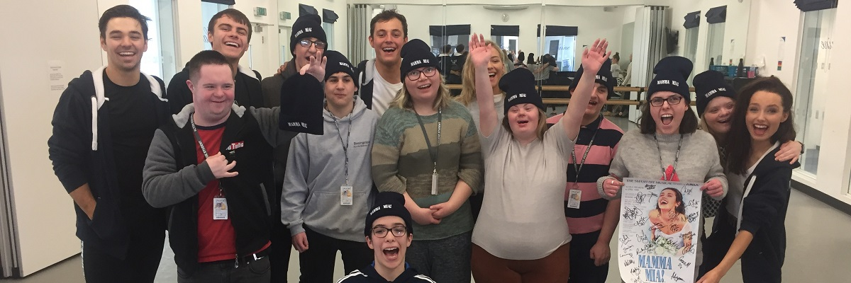 expressions creative arts students posing for a picture with cast of Mamma Mia in a dance studio