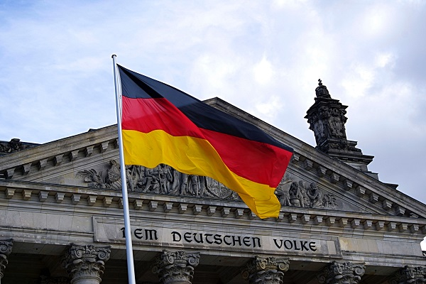 a german flag flying in the wind on a flagpole