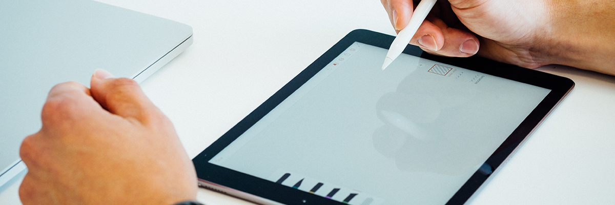 close up of someone using a tablet and stylus