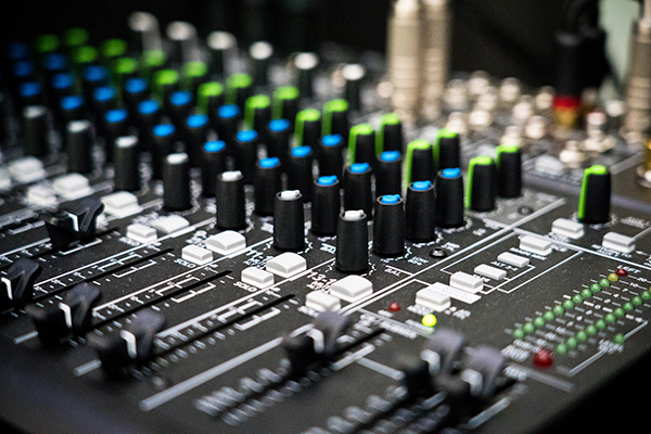 close up of music mixing equipment