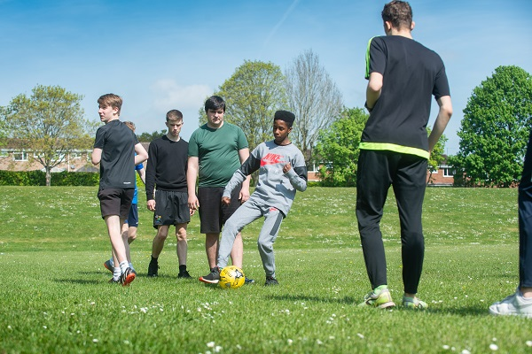 students playing football on a field