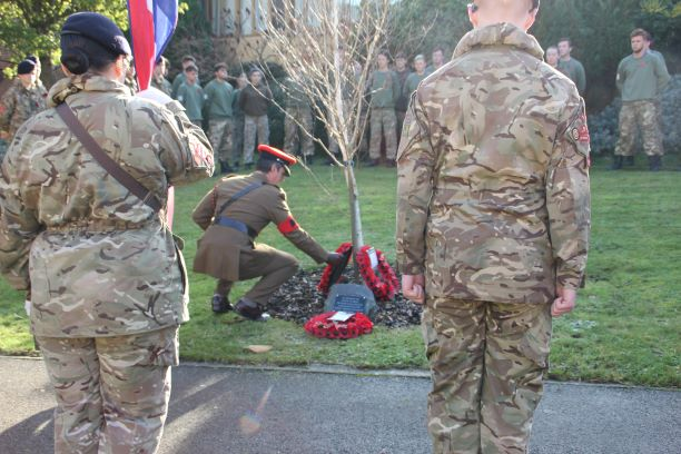 Major Dave Love laying wreath