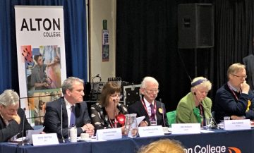 election candidates at hustings table