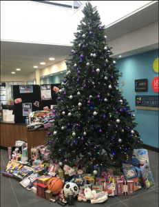 Mission Christmas donations under a Christmas Tree at South Downs Campus Reception.