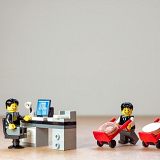 Lego figures in a business office