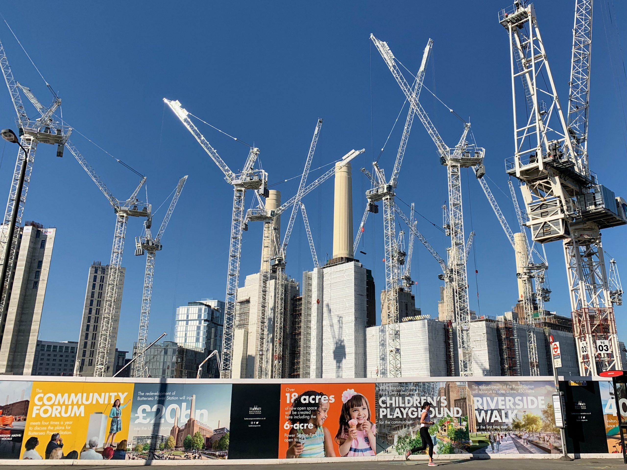 Skyline of construction cranes