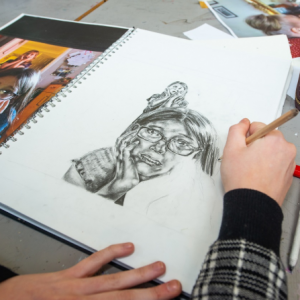 student drawing a portrait
