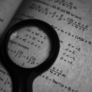 close up of maths equations in a book