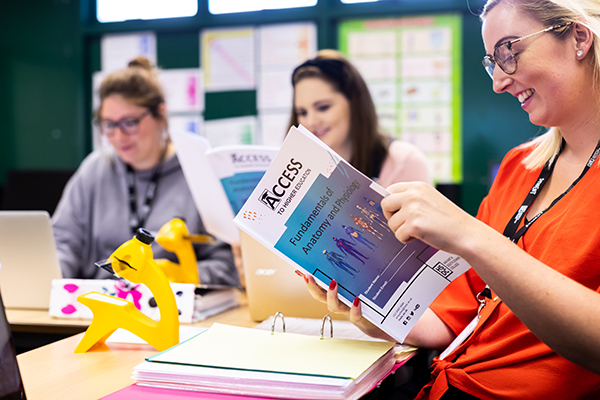access students in class with access work booklets