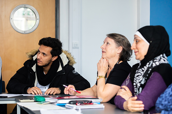 esol students listening to teacher in class