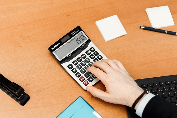 person using a calculator on a desk