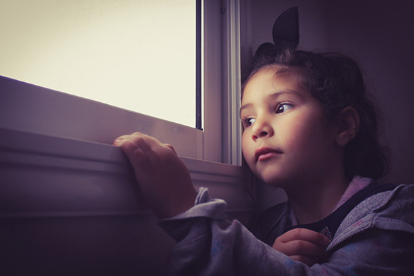 a young child looking out of a window