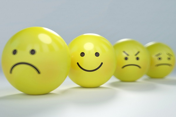 a range of emotions on yellow balls including happy, sad, angry and worried