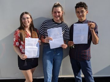 Three students with their 2020 results
