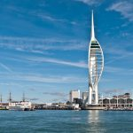 landscape picture of spinnaker tower on the water