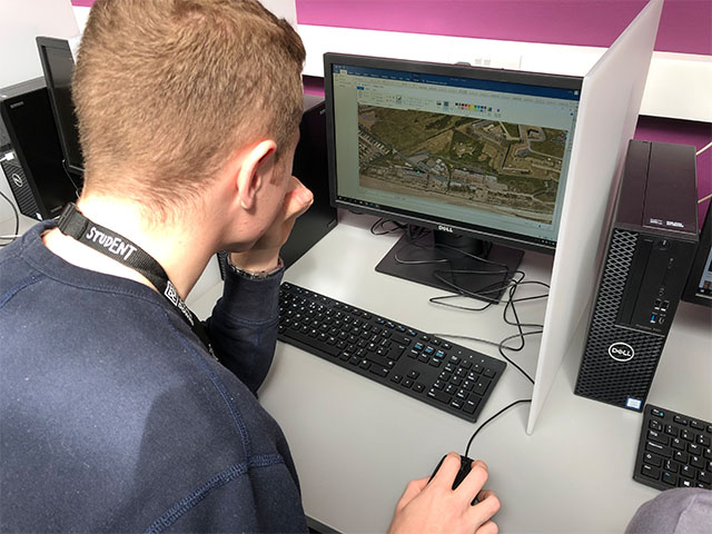 a Construction T Level student at a computer looking at building plans