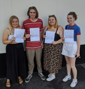 four student holding their results