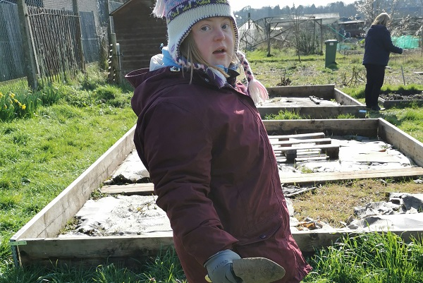 vocational and foundation learning student working in an allotment