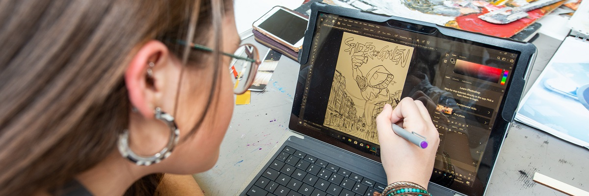 student drawing digitally on a tablet
