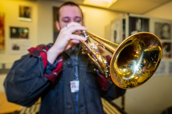 close up of a student playing trumpet