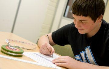 VFL student working on maths work at desk